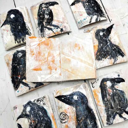 Journals with grungy crows one journal is open